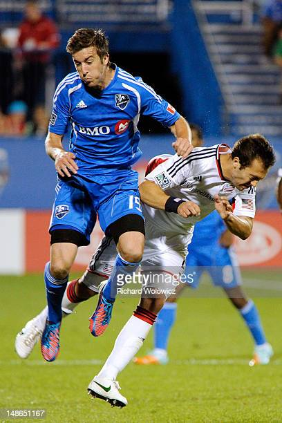Jeb Brovsky of the Montreal Impact collides with AJ Soares of the New England Revolution during the MLS match at the Saputo Stadium on July 18 2012...