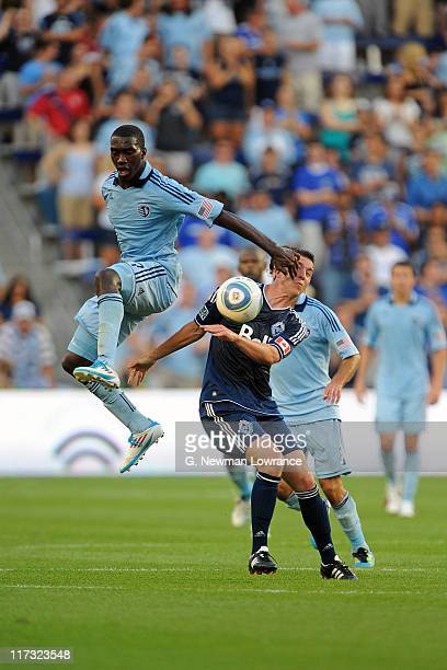 Jeb Brovsky of the Vancouver Whitecaps FC is hit in the face by CJ Sapong of Sporting Kansas City on June 25 2011 at LiveStrong Sporting Park in...