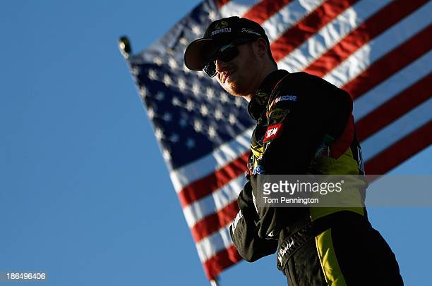 Jeb Burton driver of the Arrowhead Chevrolet looks on in the garge area during practice for the NASCAR Camping World Truck Series WinStar World...