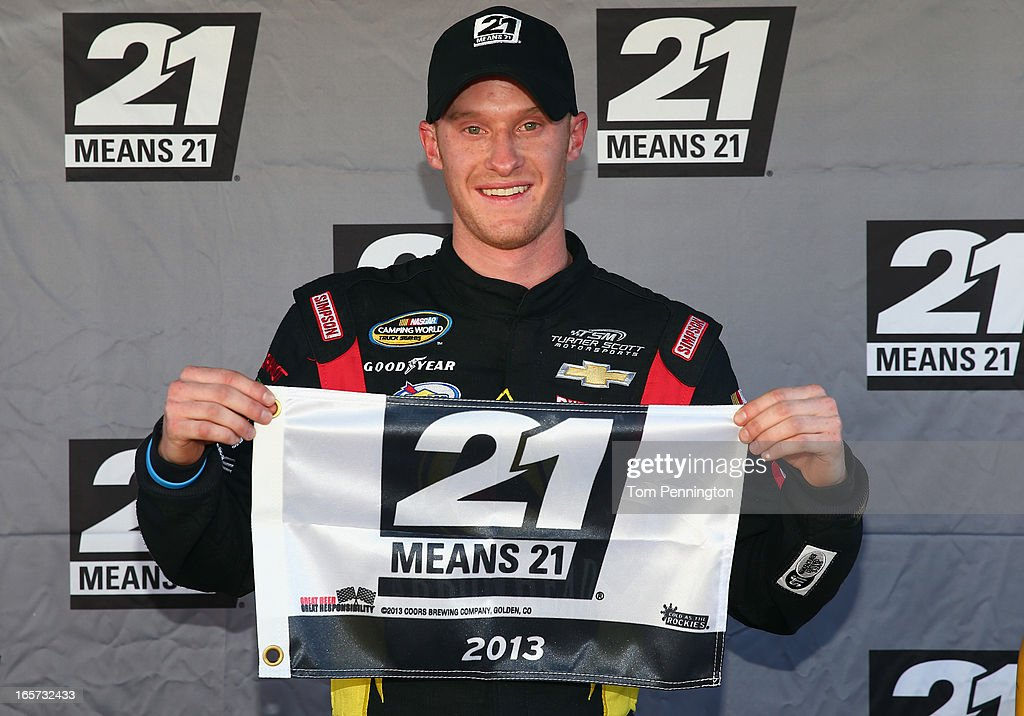 Jeb Burton, driver of the #4 Arrowhead Chevrolet, poses with the pole award during qualifying for the NASCAR Camping World Truck Series Kroger 250 on April 5, 2013 at Martinsville Speedway in Ridgeway, Virginia.
