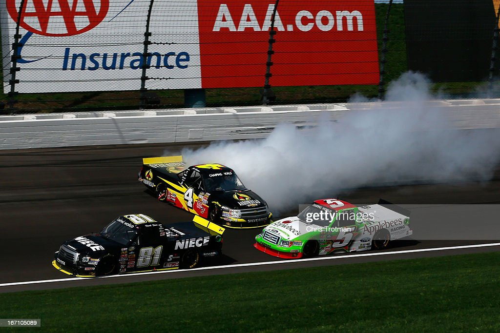 <a gi-track='captionPersonalityLinkClicked' href=/galleries/search?phrase=Jeb+Burton&family=editorial&specificpeople=8936842 ng-click='$event.stopPropagation()'>Jeb Burton</a>, driver of the #4 Arrowhead Chevrolet spins on the track as David Starr, driver of the #81 SS-Green Light Racing Toyota and Tim George Jr., driver of the #5 Applebee's Ford drive by during the NASCAR Camping World Truck Series SFP 250 at Kansas Speedway on April 20, 2013 in Kansas City, Kansas.