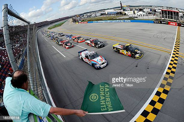 Jeb Burton driver of the Arrowhead / Kangaroo Express Dodge and Max Gresham driver of the Made in USA Chevrolet lead the field at the start of the...