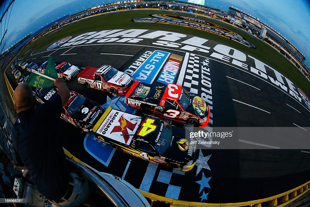 <a gi-track='captionPersonalityLinkClicked' href=/galleries/search?phrase=Jeb+Burton&family=editorial&specificpeople=8936842 ng-click='$event.stopPropagation()'>Jeb Burton</a>, driver of the #4 Arrowhead/Kangaroo Express Chevrolet, and <a gi-track='captionPersonalityLinkClicked' href=/galleries/search?phrase=Ty+Dillon&family=editorial&specificpeople=6312493 ng-click='$event.stopPropagation()'>Ty Dillon</a>, driver of the #3 Bass Pro Shops/NWTF Chevrolet, lead the field past the green flag to start the NASCAR Camping World Truck Series North Carolina Education Lottery 200 at Charlotte Motor Speedway on May 17, 2013 in Concord, North Carolina.