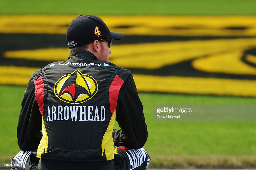 Jeb Burton, driver of the #4 Arrowhead/Kangaroo Express Chevrolet, looks on during qualifying for the NASCAR Camping World Truck Series North Carolina Education Lottery 200 at Charlotte Motor Speedway on May 17, 2013 in Concord, North Carolina.