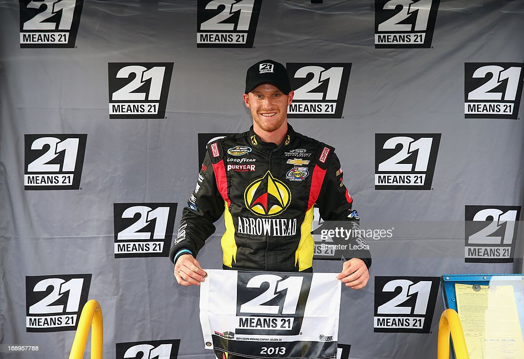 Jeb Burton, driver of the #4 Arrowhead/Kangaroo Express Chevrolet, poses for a photo after winning the pole position during qualifying for the NASCAR Camping World Truck Series North Carolina Education Lottery 200 at Charlotte Motor Speedway on May 17, 2013 in Concord, North Carolina.