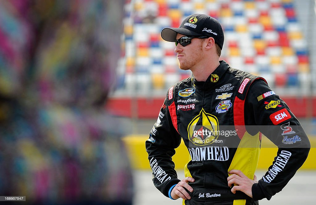 Jeb Burton, driver of the #4 Arrowhead/Kangaroo Express Chevrolet, waits to qualify for the NASCAR Camping World Truck Series North Carolina Education Lottery 200 at Charlotte Motor Speedway on May 17, 2013 in Concord, North Carolina.