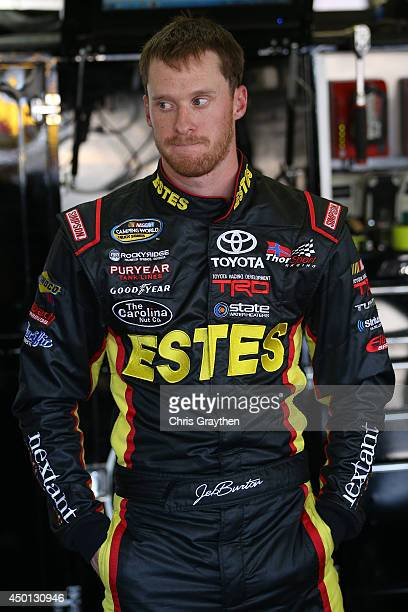 Jeb Burton driver of the Estes Toyota stands in the garage area during practice for the NASCAR Camping World Truck Series WinStar World Casino Resort...