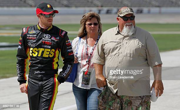 Jeb Burton driver of the Estes Toyota walks with John Godwin of the TV show Duck Dynasty during NTT DATA Qualifying for the NASCAR Camping World...