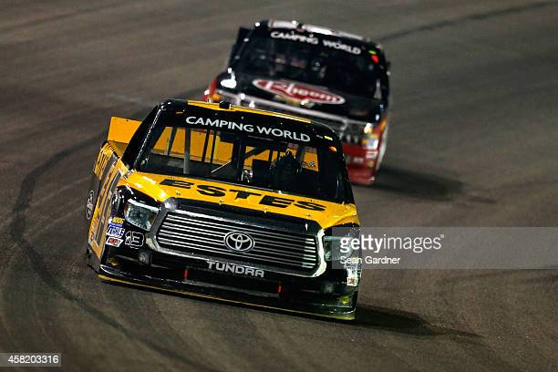 Jeb Burton driver of the Estes/Carolina Nut Company Toyota leads Ron Hornaday Jr driver of the Rheem Chevrolet during the NASCAR Camping World Truck...