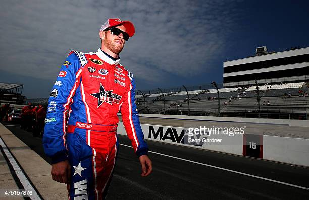 Jeb Burton driver of the Maxim Fantasy Sports Toyota walks on the grid prior to qualifying for the NASCAR Sprint Cup Series FedEx 400 Benefiting...