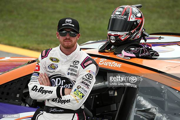 Jeb Burton driver of the Overture Toyota stands on the grid during qualifying for the NASCAR Sprint Cup Series CampingWorldcom 500 at Talladega...