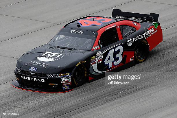 Jeb Burton driver of the Rocky Ridge Custom Trucks Ford practices for the NASCAR XFINITY Series Ollie's Bargain Outlet 200 at Dover International...