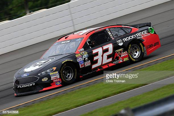 Jeb Burton driver of the Rocky Ridge Custom Trucks Ford qualifies for the NASCAR Sprint Cup Series Axalta 'We Paint Winners' 400 at Pocono Raceway on...