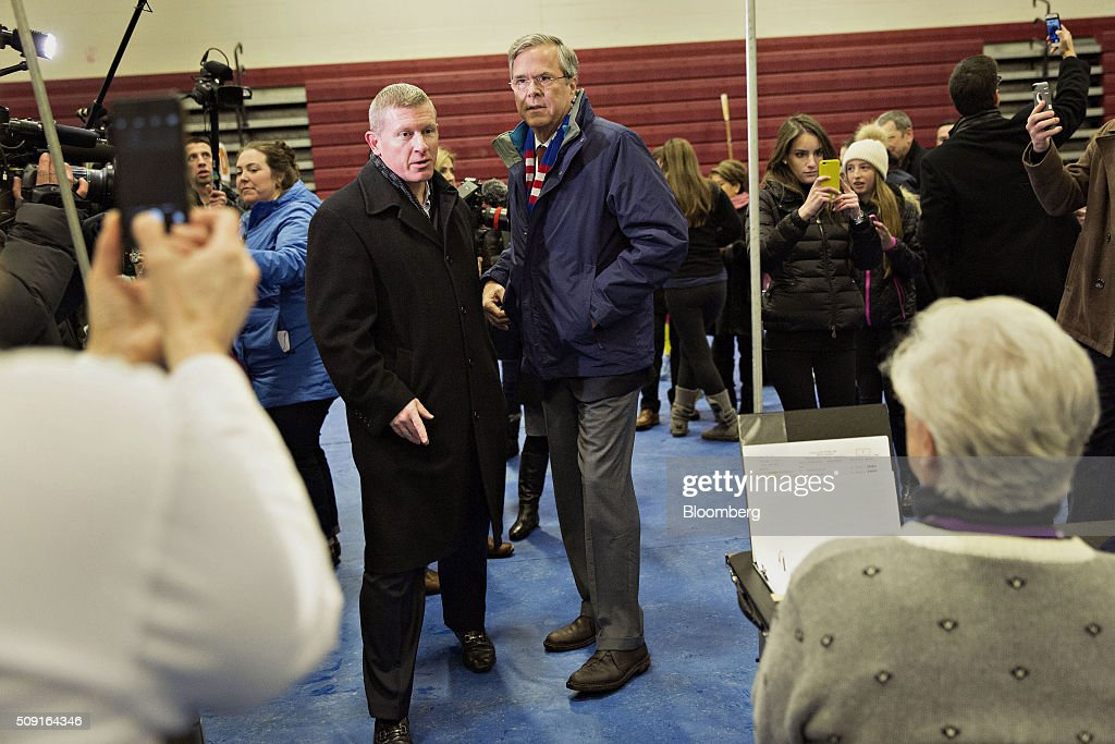 <a gi-track='captionPersonalityLinkClicked' href=/galleries/search?phrase=Jeb+Bush&family=editorial&specificpeople=171487 ng-click='$event.stopPropagation()'>Jeb Bush</a>, former governor of Florida and 2016 Republican presidential candidate, center, arrives at a polling station in Bedford, New Hampshire, U.S., on Tuesday, Feb. 9, 2016. Voters in New Hampshire took to the polls today in the nation's first primary in the U.S. presidential race. Photographer: Daniel Acker/Bloomberg via Getty Images