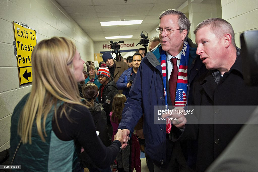 <a gi-track='captionPersonalityLinkClicked' href=/galleries/search?phrase=Jeb+Bush&family=editorial&specificpeople=171487 ng-click='$event.stopPropagation()'>Jeb Bush</a>, former governor of Florida and 2016 Republican presidential candidate, center, greets a resident during a visit to a polling station in Bedford, New Hampshire, U.S., on Tuesday, Feb. 9, 2016. Voters in New Hampshire took to the polls today in the nation's first primary in the U.S. presidential race. Photographer: Daniel Acker/Bloomberg via Getty Images