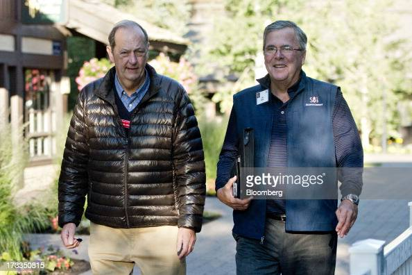 Jeb Bush former governor of Florida right walks with Bill Bradley former US Senator as they arrive for a morning session during the Allen Co Media...