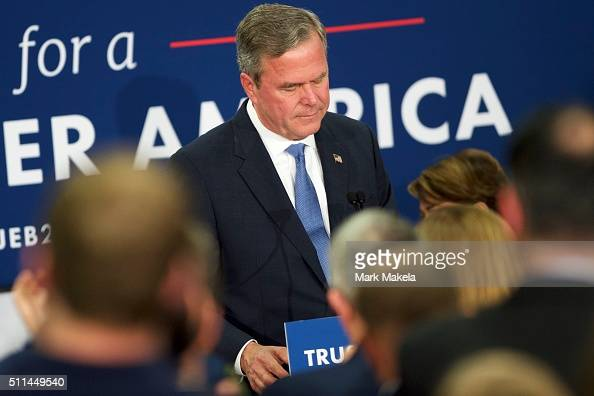 Jeb Bush reacts as he announces the suspension of his presidential campaign during an election night party at the Hilton Columbia Center on February...