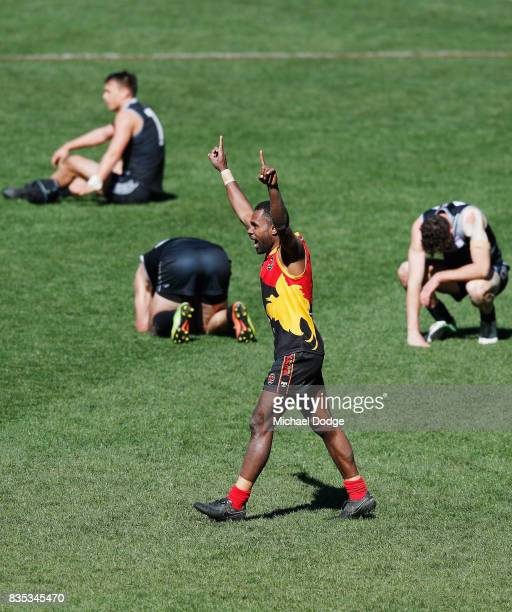 Jeconiah PENI of Papua New Guinea celebrates the win on the siren during the 2017 AFL International Cup Grand FInal match between New Zealand and...