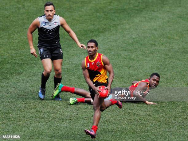 Jeconiah PENI of Papua New Guinea runs with the ball during the 2017 AFL International Cup Grand FInal match between New Zealand and Papua New Guinea...
