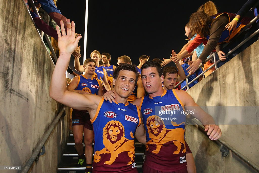 Jed Adcock and Tom Rockcliff of the Lions celebrates winning the round 22 AFL match between the Brisbane Lions and the Western Bulldogs at The Gabba on August 25, 2013 in Brisbane, Australia.