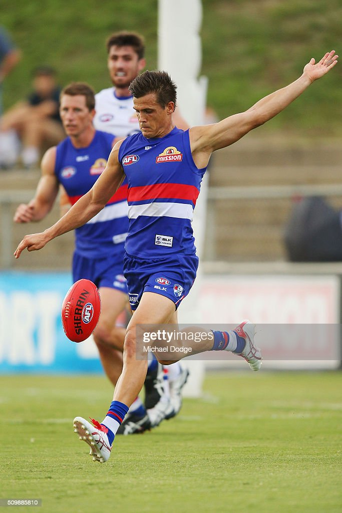 Jed Adcock of the Bulldogs kicks the ball during the Western Bulldogs AFL intra-club match at Whitten Oval on February 13, 2016 in Melbourne, Australia.