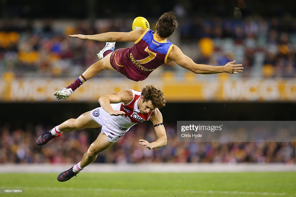 Jed Adcock of the Lions and Nick Smith of the Swans collide during the round 15 AFL match between the Brisbane Lions and the Sydney Swans at The Gabba on July 12, 2015 in Brisbane, Australia.