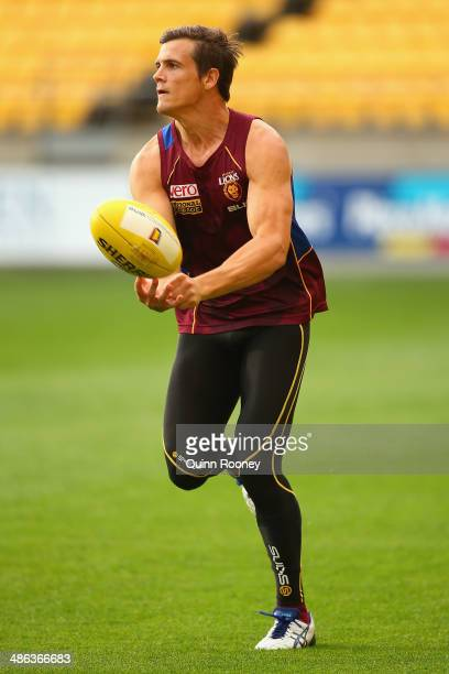 Jed Adcock of the Lions handballs during a Brisbane Lions AFL training session at Westpac Stadium on April 24 2014 in Wellington New Zealand