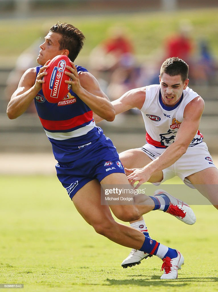 Jed Adcock runs with the ball during the Western Bulldogs AFL intra-club match at Whitten Oval on February 13, 2016 in Melbourne, Australia.