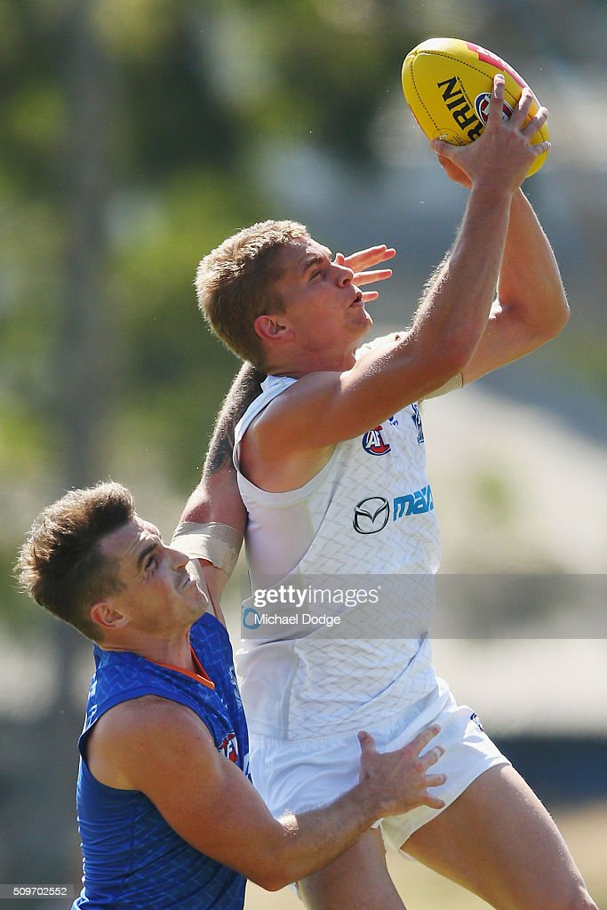 Jed Anderson of the Kangaroos marks the ball against Aaron Mullett of the Kangaroos during the North Melbourne AFL Intra-Club match at Arden Street Ground on February 12, 2016 in Melbourne, Australia.