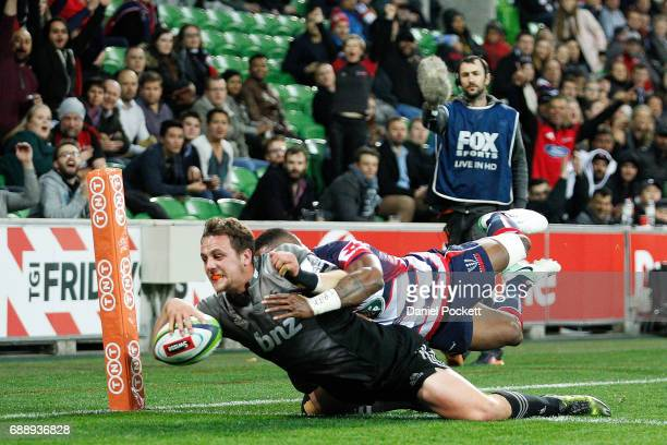 Jed Brown of the Crusaders scores a try during the round 14 Super Rugby match between the Rebels and the Crusaders at AAMI Park on May 27 2017 in...