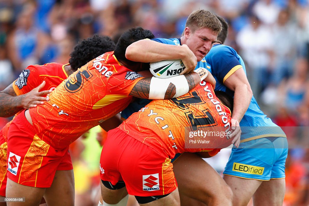 Jed Cartwright of the Titans is tackled during the NRL Trial Match between the New Zealand Warriors and the Gold Coast Titans at Toll Stadium on February 13, 2016 in Whangarei, New Zealand.