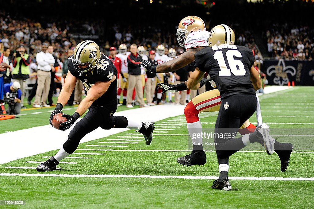 Jed Collins #45 of the New Orleans Saints scores a touchdown during a game against the San Francisco 49ers at the Mercedes-Benz Superdome on November 25, 2012 in New Orleans, Louisiana.