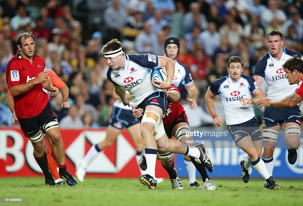 Jed Holloway of the Waratahs takes on the defence during the Super Rugby trial match between the Waratahs and the Crusaders at Allianz Stadium on February 14, 2013 in Sydney, Australia.