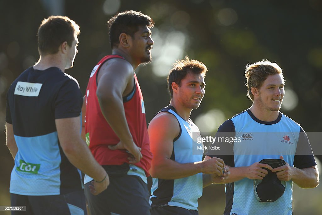Jed Holloway, Will Skelton, Nick Phipps and Michael Hooper watch on during a Waratahs Super Rugby training session at Kippax Lake on May 3, 2016 in Sydney, Australia.