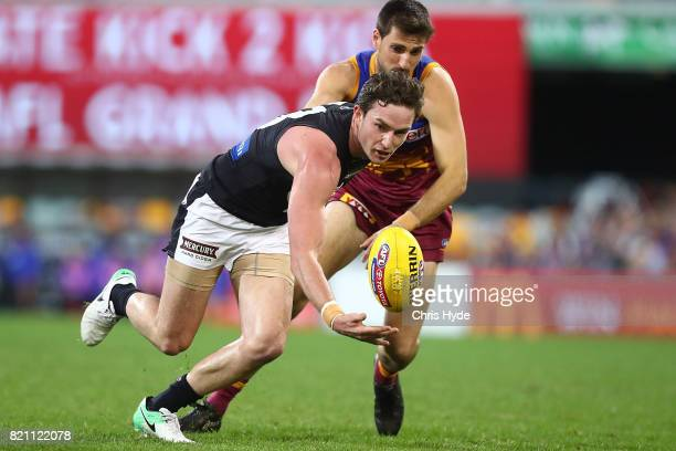 Jed Lamb of the Blues and Sam Mayes of the Lions compete for the ball during the round 18 AFL match between the Brisbane Lions and the Carlton Blues...
