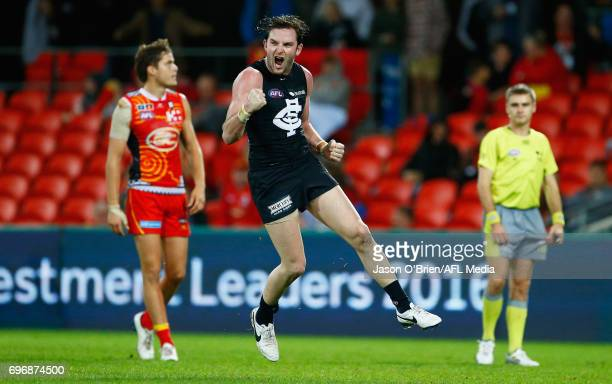 Jed Lamb of the Blues celebrates a goal during the round 13 AFL match between the Gold Coast Suns and the Carlton Blues at Metricon Stadium on June...