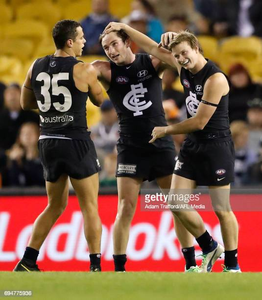 Jed Lamb of the Blues celebrates a goal with Ed Curnow and Liam Sumner of the Blues during the 2017 AFL round 12 match between the Carlton Blues and...