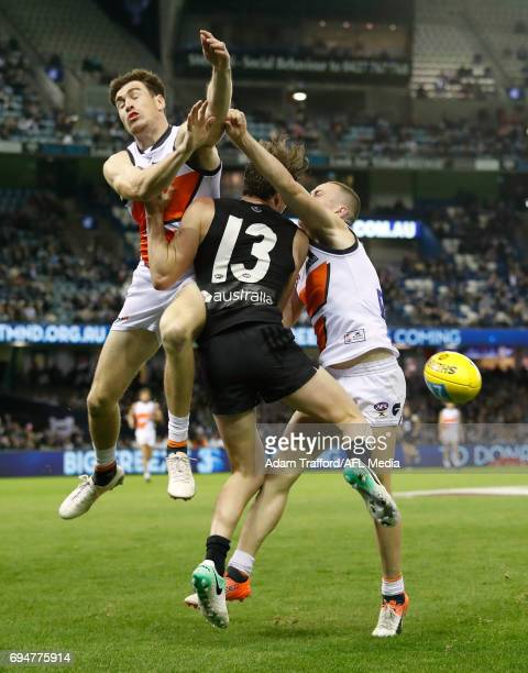 Jed Lamb of the Blues is bumped by Jeremy Cameron of the Giants during the 2017 AFL round 12 match between the Carlton Blues and the GWS Giants at...
