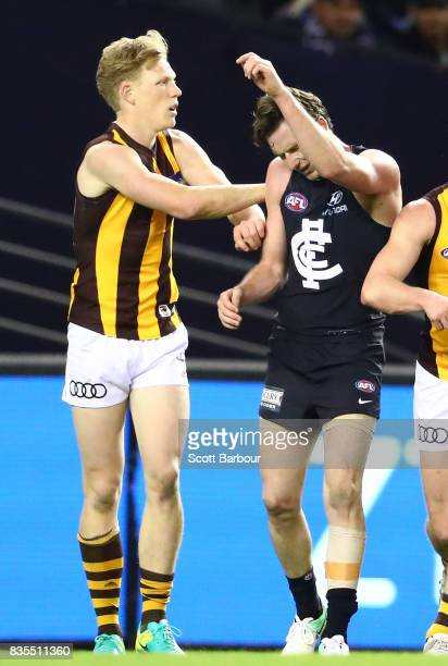 Jed Lamb of the Blues is pushed by James Sicily of the Hawks during the round 22 AFL match between the Carlton Blues and the Hawthorn Hawks at Etihad...