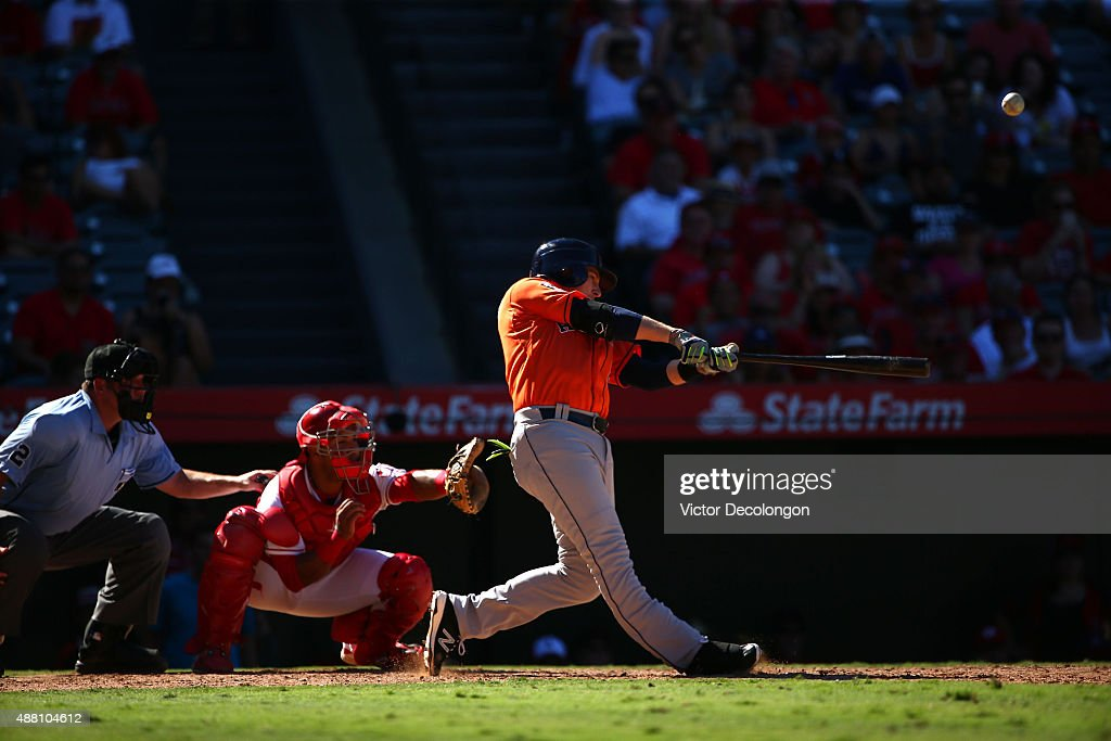 Jed Lowrie #8 of the Houston Astros hits a three-run homerun in the ninth inning during the MLB game against the Los Angeles Angels of Anaheim to take a 5-3 lead after being down 3-0 to begin the ninth at Angel Stadium of Anaheim on September 13, 2015 in Anaheim, California.