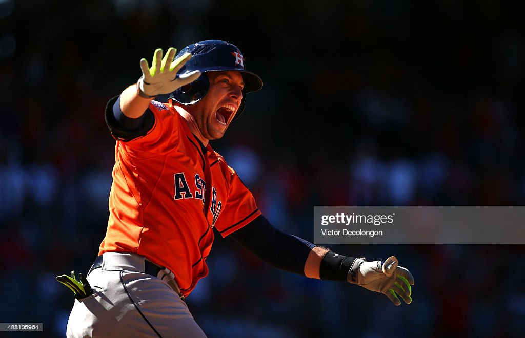 Jed Lowrie #8 of the Houston Astros reacts after hitting a three-run homerun in the ninth inning to take a 5-3 lead after trailing the Los Angeles Angels of Anaheim 3-0 going into the ninth during the MLB game at Angel Stadium of Anaheim on September 13, 2015 in Anaheim, California. The Astros defeated the Angels 5-3.