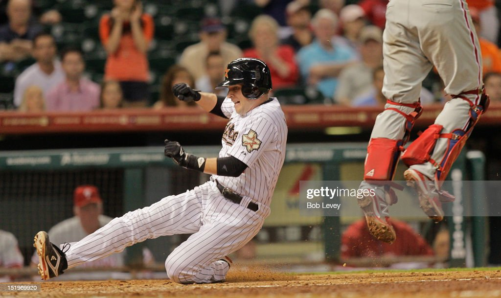 <a gi-track='captionPersonalityLinkClicked' href=/galleries/search?phrase=Jed+Lowrie&family=editorial&specificpeople=4949369 ng-click='$event.stopPropagation()'>Jed Lowrie</a> #4 of the Houston Astros scores in the eighth inning against the Philadelphia Phillies at Minute Maid Park on September 13, 2012 in Houston, Texas. Houston wins 6-4.
