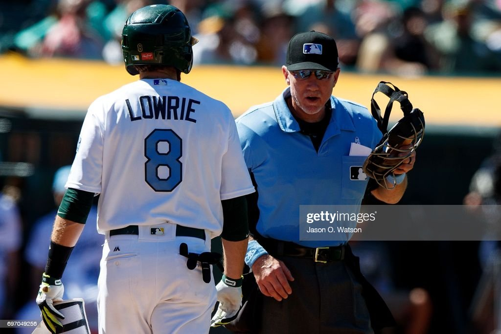 Jed Lowrie #8 of the Oakland Athletics argues with umpire Lance Barksdale #23 after striking out against the New York Yankees during the ninth inning at the Oakland Coliseum on June 17, 2017 in Oakland, California. The Oakland Athletics defeated the New York Yankees 5-2. Players and umpires are wearing blue to celebrate Father's Day weekend and support prostrate cancer awareness.