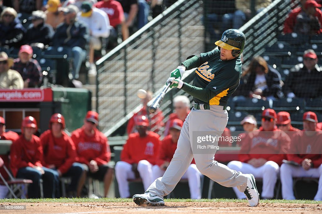 <a gi-track='captionPersonalityLinkClicked' href=/galleries/search?phrase=Jed+Lowrie&family=editorial&specificpeople=4949369 ng-click='$event.stopPropagation()'>Jed Lowrie</a> #8 of the Oakland Athletics bats during the game against the Los Angeles Angeles of Anaheim on February 24, 2013 at Tempe Diablo Stadium in Tempe, Arizona. The Athletics defeated the Angels 7-5.