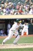 Jed Lowrie of the Oakland Athletics bunts during the game against the Tampa Bay Rays at Oco Coliseum on September 1 2013 in Oakland California The...
