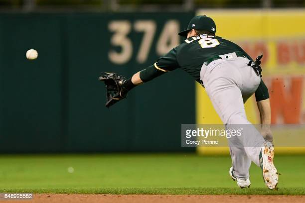 Jed Lowrie of the Oakland Athletics can't get to a ball just out of reach against the Philadelphia Phillies during the third inning at Citizens Bank...