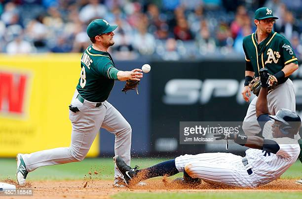 Jed Lowrie of the Oakland Athletics completes a second inning ending double play after forcing out Alfonso Soriano of the New York Yankees at Yankee...