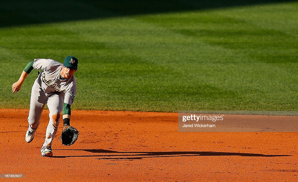 Jed Lowrie #8 of the Oakland Athletics fields a ground ball against the Boston Red Sox during the game on April 24, 2013 at Fenway Park in Boston, Massachusetts.