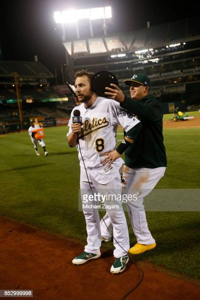 Jed Lowrie of the Oakland Athletics gets pied by Ryon Healy after hitting a walkoff single following the game against the Houston Astros at the...