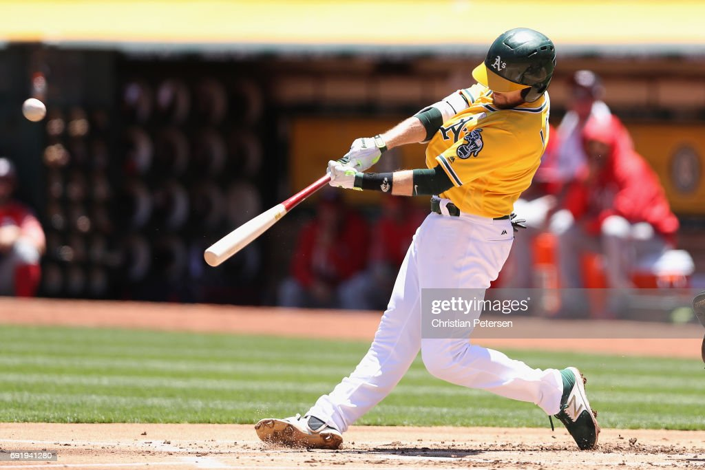 Jed Lowrie #8 of the Oakland Athletics hits a two run home run against the Washington Nationals during the first inning of the MLB game at Oakland Coliseum on June 3, 2017 in Oakland, California.